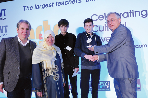 Teachers at Dawn House School Andrew Metcalfe and Yasumin Alkattan, winning pupils from Dawn House School Alex Kendrick-Allen and Thomas Hitchen and NASUWT President Geoff Branner, who presented them with the award