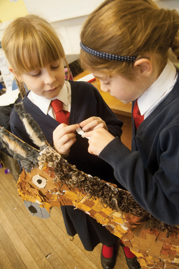 L to R: Rosie Callicott Year 3 and Maddy Lynch Year 4 working hard on their part for the giant nativity scene