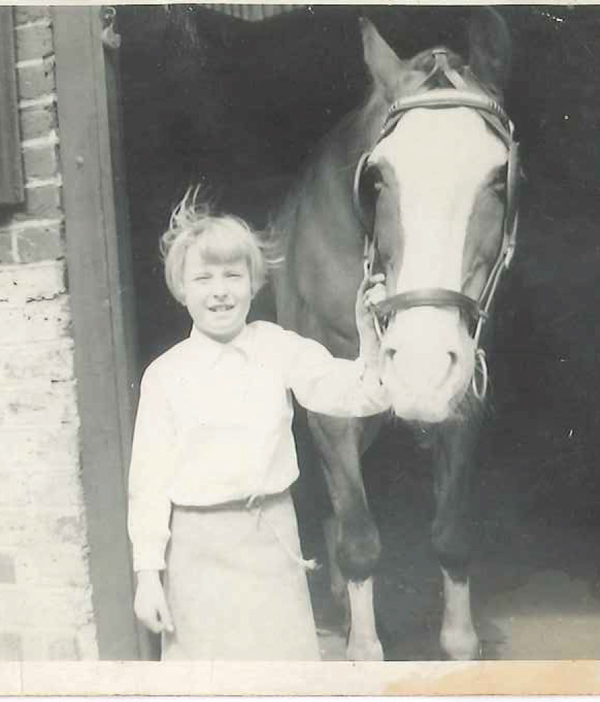 Sue aged 9 at her grandfather's forge, wearing a leather apron her grandfather made
