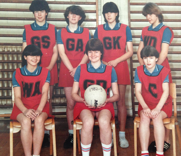Jo-Anne (second from right, back row) playing as Goal Keeper in her school netball team
