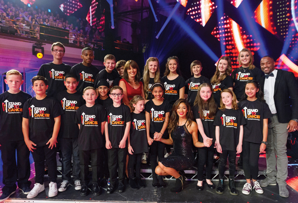 Adam Brombley (back left), 15, takes part in Stand Up 2 Cancer with Nicole Scherzinger and Davina McCall