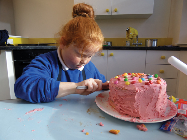 Year 4 student Kiera Price puts the icing  on her cake