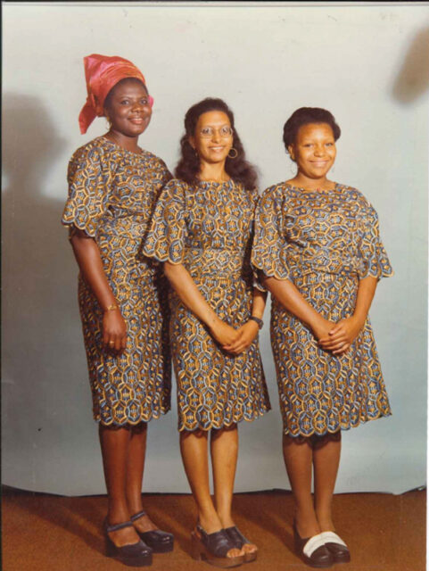 Aged 18 with two of her sisters in Lagos, Nigeria