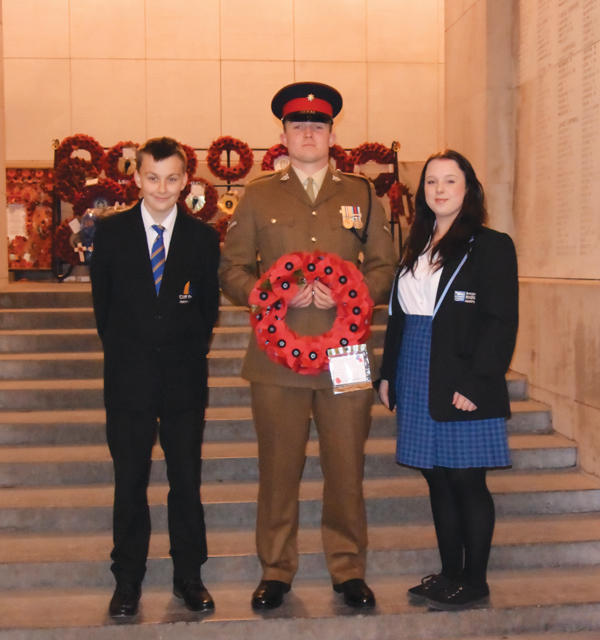 Daniel Powell from Cliff Park Ormiston Academy and Leonie Hunt from Ormiston Rivers Academy join Lance Corporal Liam Parker in laying a wreath at the Last Post Ceremony in Ypres