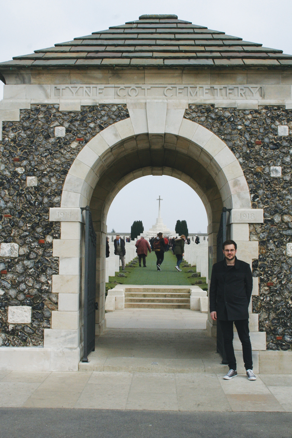 John Dickens at the entrance to the Tyne Cot Cemetery