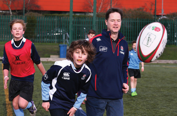 Former deputy prime minister Nick Clegg takes part in rugby practice with pupils of Twickenham Academy