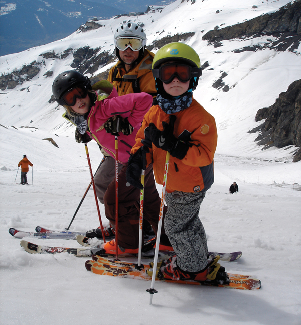 Tim skiing with children Erin (11) and Alex (9)