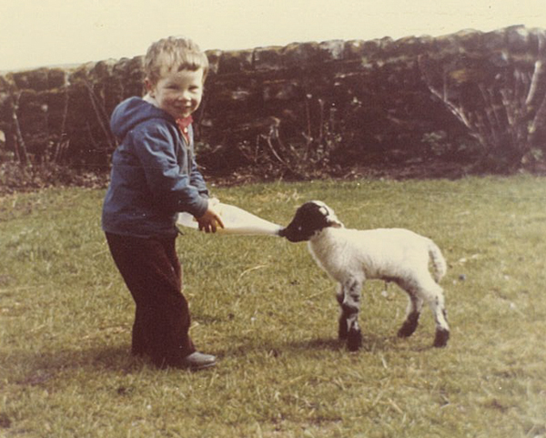 Neil feeding a lamb at the family farm near Elston