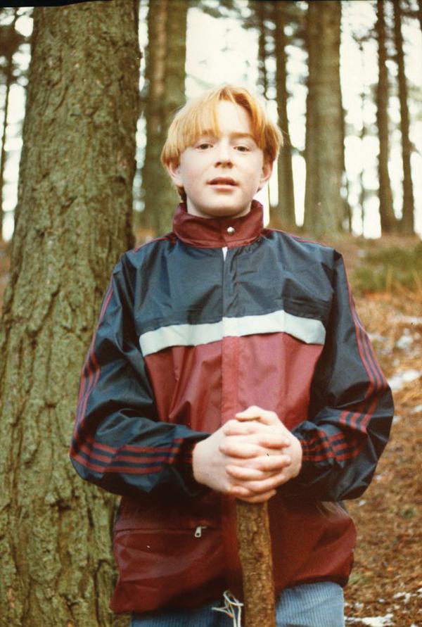 David aged 13 holding a stick
