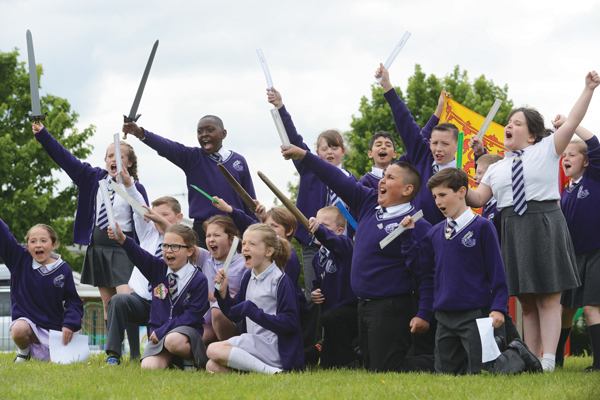 Above: Pupils perform Henry V for number 18, take part in a play