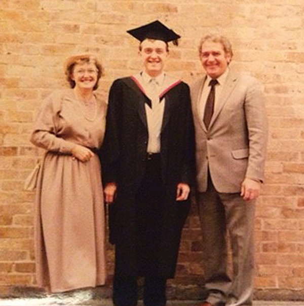 . . . and with his parents on graduation day