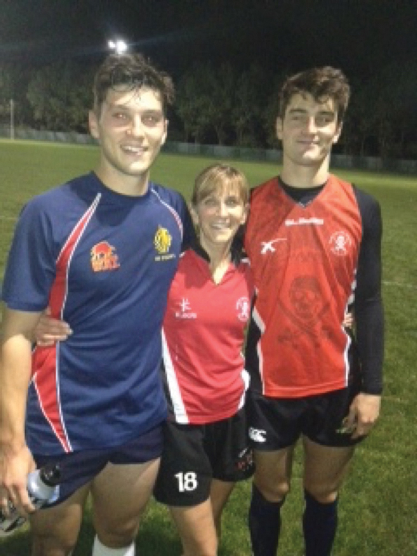 Playing tag rugby with sons Crawford (left) and Sinclair (right)