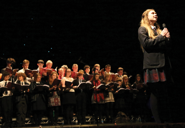 Olivia Hewitt-Jones performing a solo accompanied by Caterham School Chamber Choir