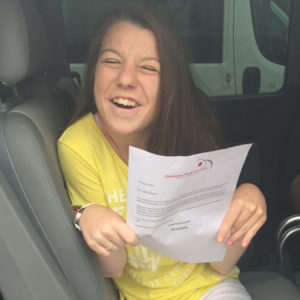 Abbie celebrates grades after overcoming severe disability