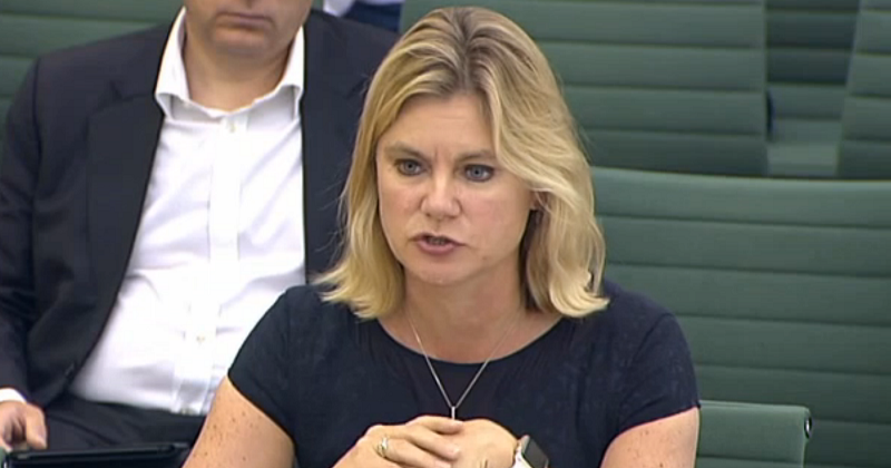 Justine Greening holds up findings of the Teachers Working Longer Review