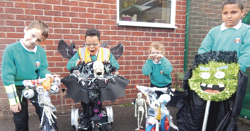 Pupils ride to school on bikes covered in Halloween decorations for annual Bike-o-Ween