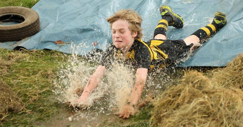 Seven schools compete in muddy obstacle course