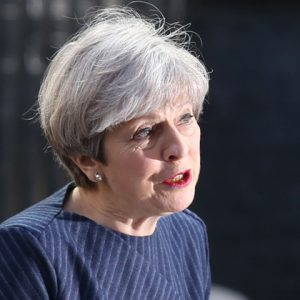 May 'drops' plans to axe free meals for infants from Queen's Speech
