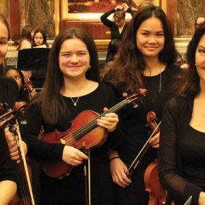 Pupils perform alongside famous violinist at school's 95th anniversary celebrations