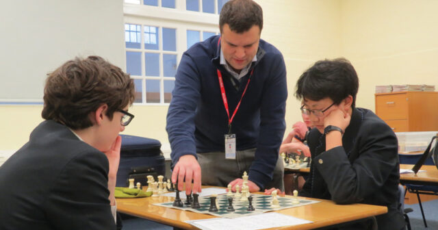 Former chess world champion mentors school chess team