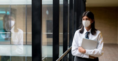 The government has changed its policy on face coverings for pupils going to school.