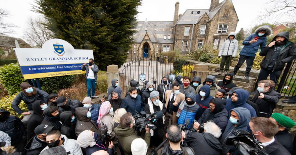 Protests outside Batley Grammar School over a now-suspended teacher's use of caricatures of Prophet Muhammad.